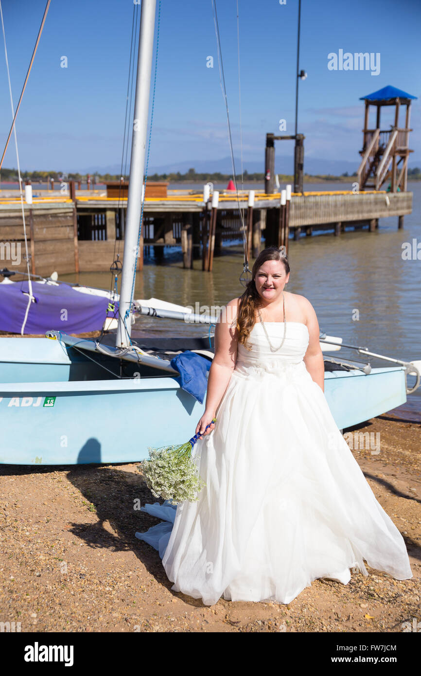 Portrait of a bride in her wedding dress outdoors in Oregon at a ...