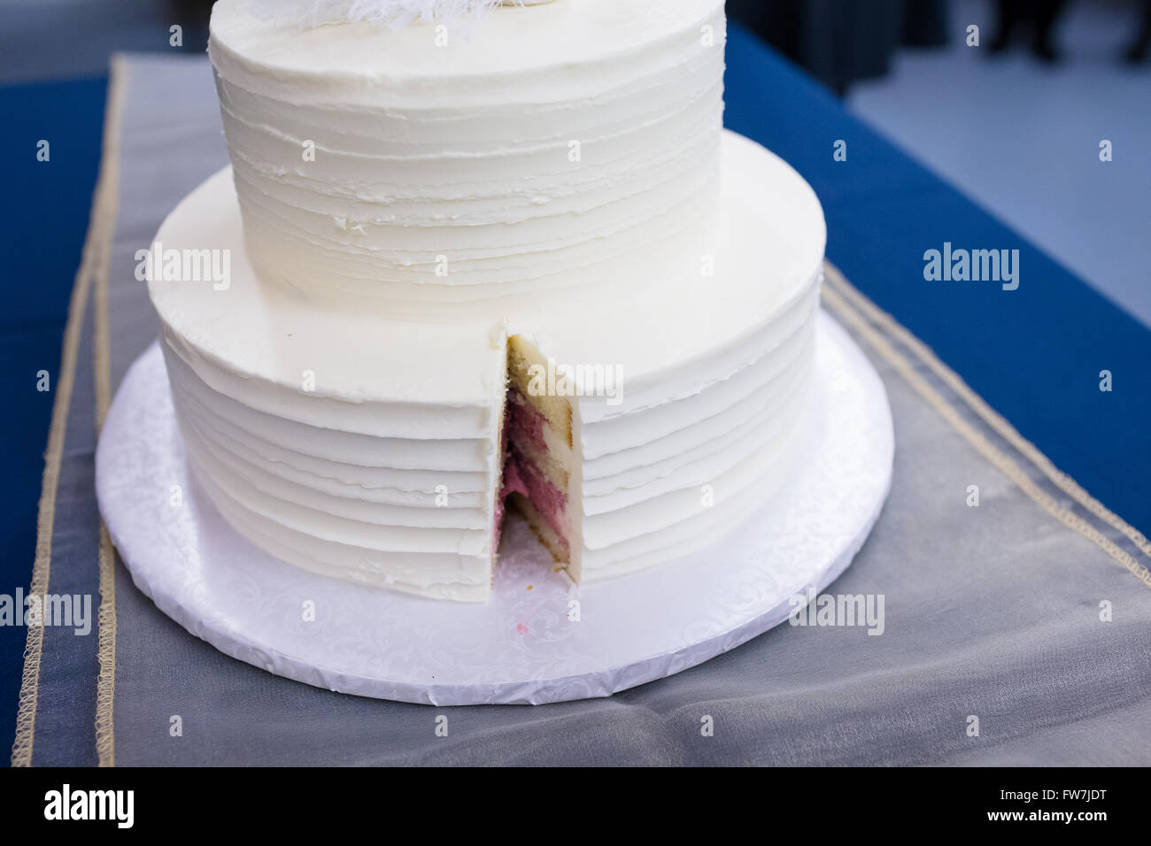 White Cake At A Wedding Reception For The Bride And Groom To Cut The Stock Photo Royalty Free