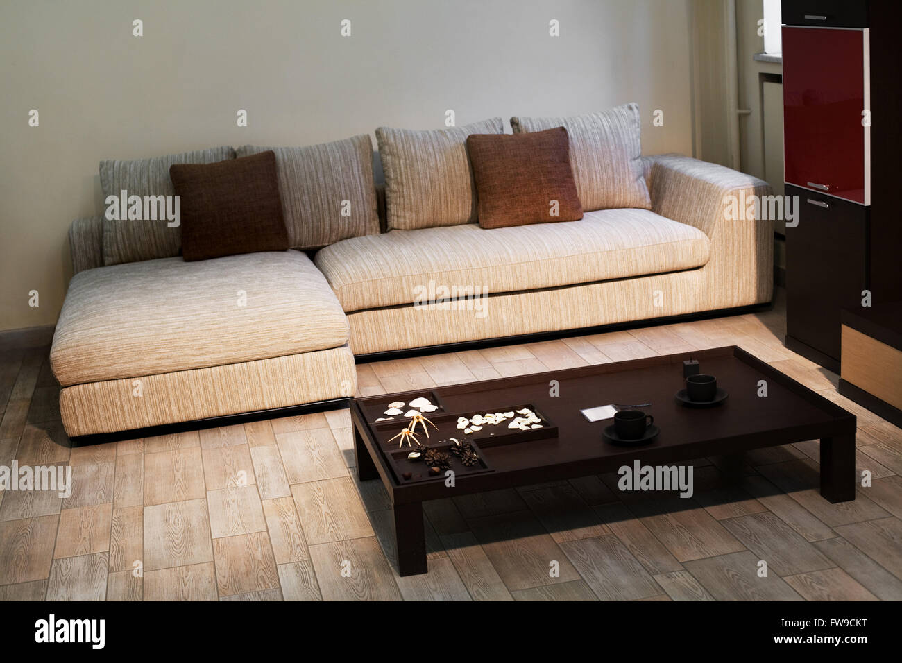 beautiful sofa with pillows and a table from a dark wooden stock photo royalty free image. Black Bedroom Furniture Sets. Home Design Ideas