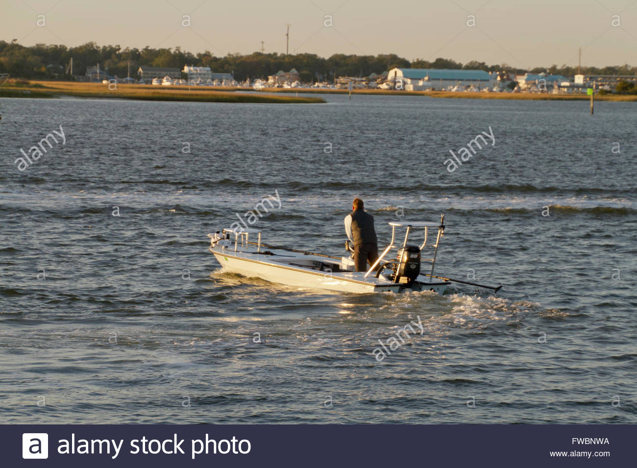 Atlantic intracoastal waterway wrightsville beach north carolina atlantic intracoastal waterway wrightsville beach north carolina usa november 13 2015 a man takes off in a speedboat nea publicscrutiny Images