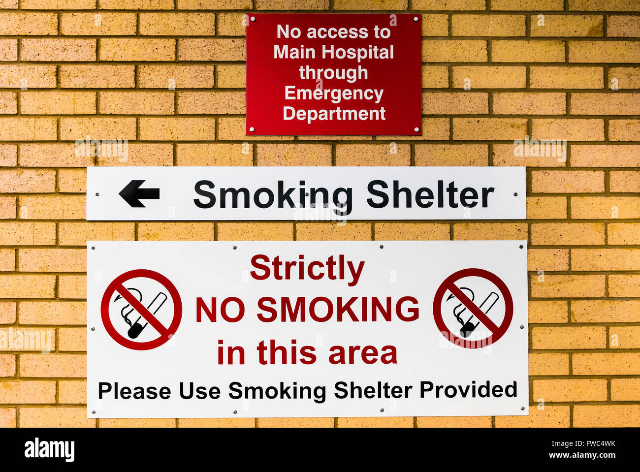 Signs at the entrance of a hospital emergency department warning signs at the entrance of a hospital emergency department warning tha no access to the main hospital is possible and smoking is sciox Image collections