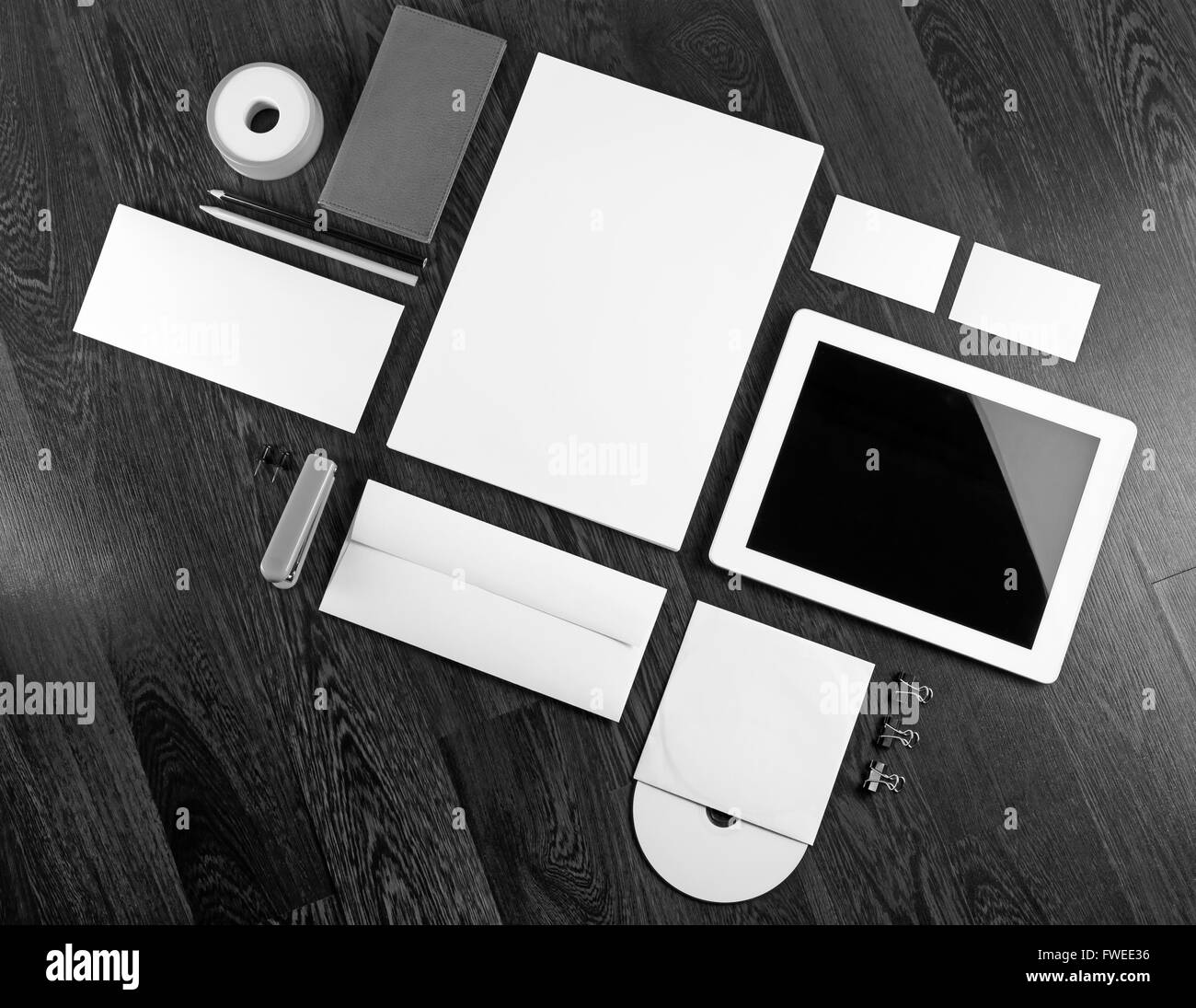 Blank Stationery And Corporate Identity Template Consist: Photo Of Blank Corporate Identity Template On Dark Wooden