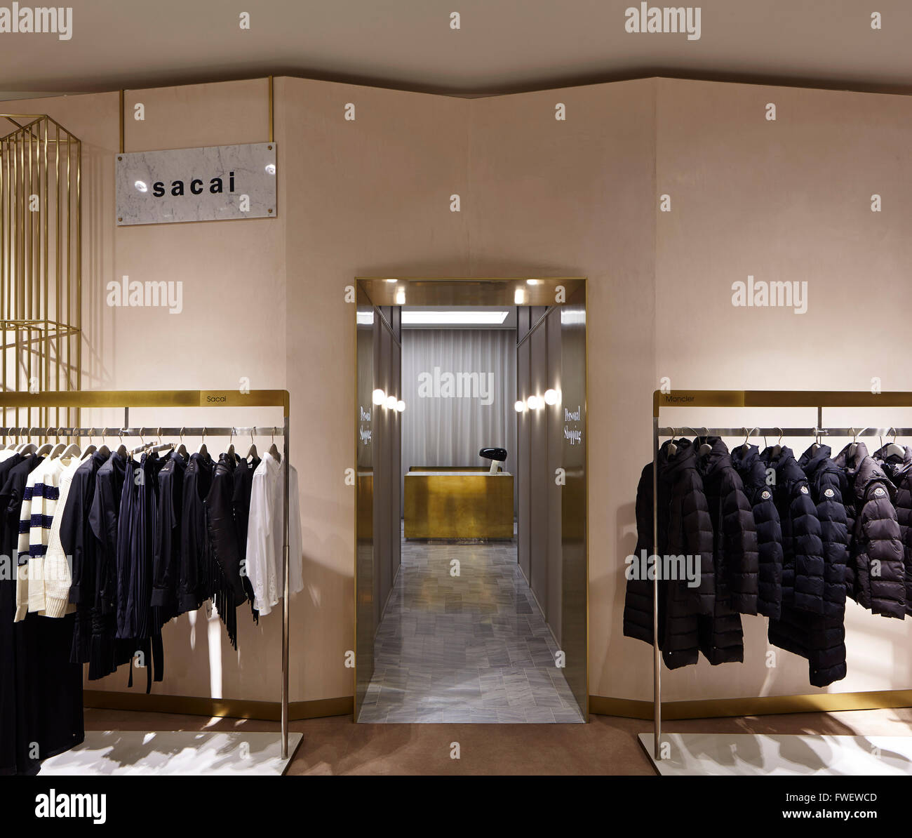 stock photo the personal shopping area showing concierge desk raw plaster faceted walls lined with jackets and coats selfridges manchest - Concierge Desk Design
