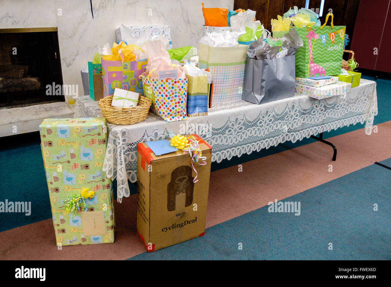 A baby shower gift table with colorful packages and a lace stock a baby shower gift table with colorful packages and a lace tablecloth usa negle Gallery