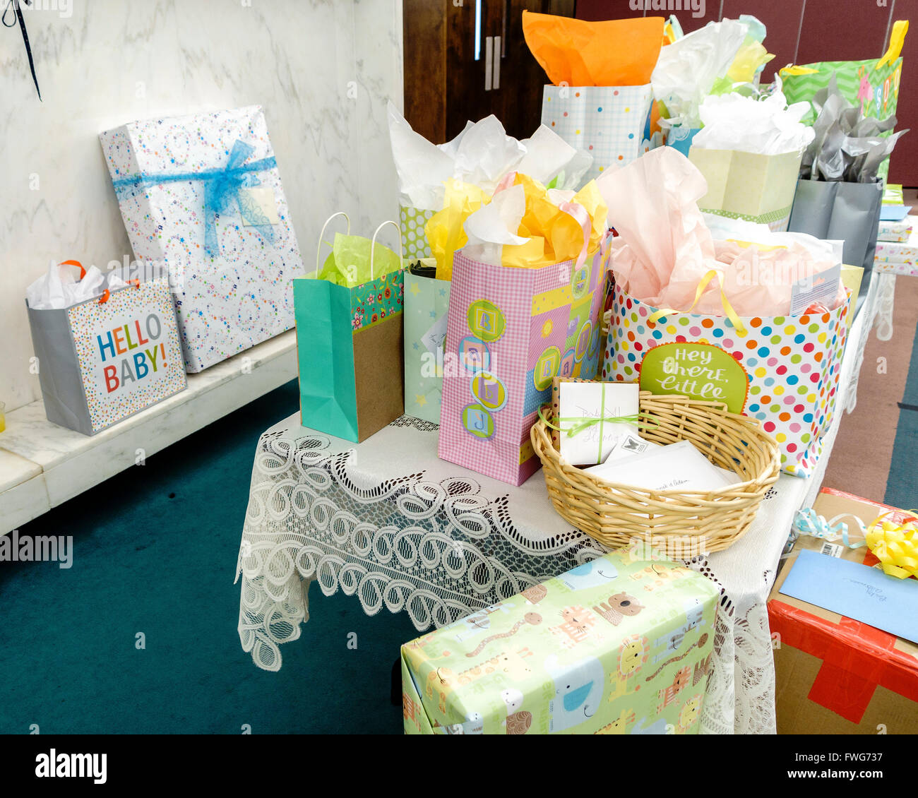 A Baby Shower Gift Table With Colorful Packages And A Lace Tablecloth. USA