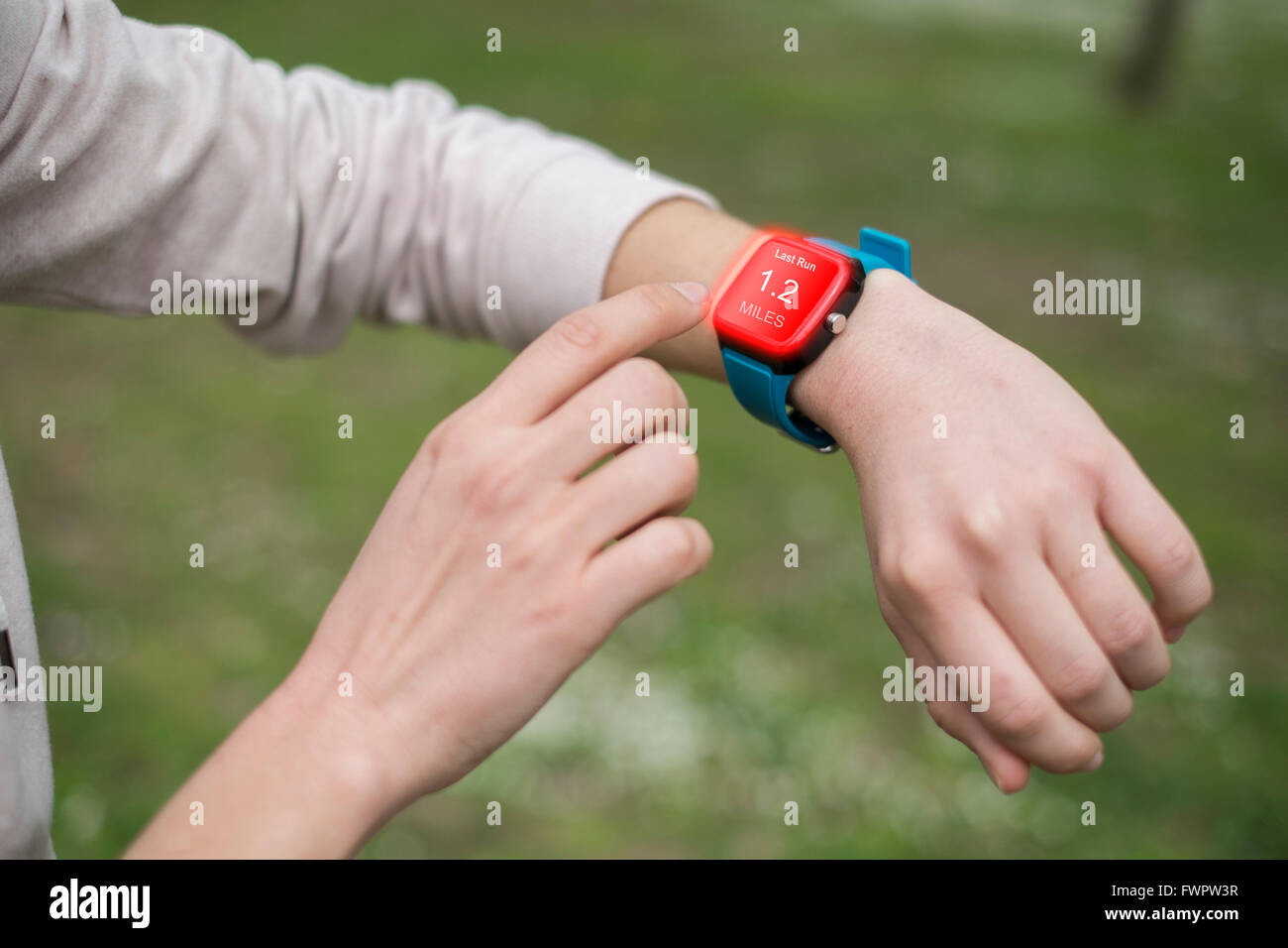Girl hands touching the touch screen of the smart watch that she ...