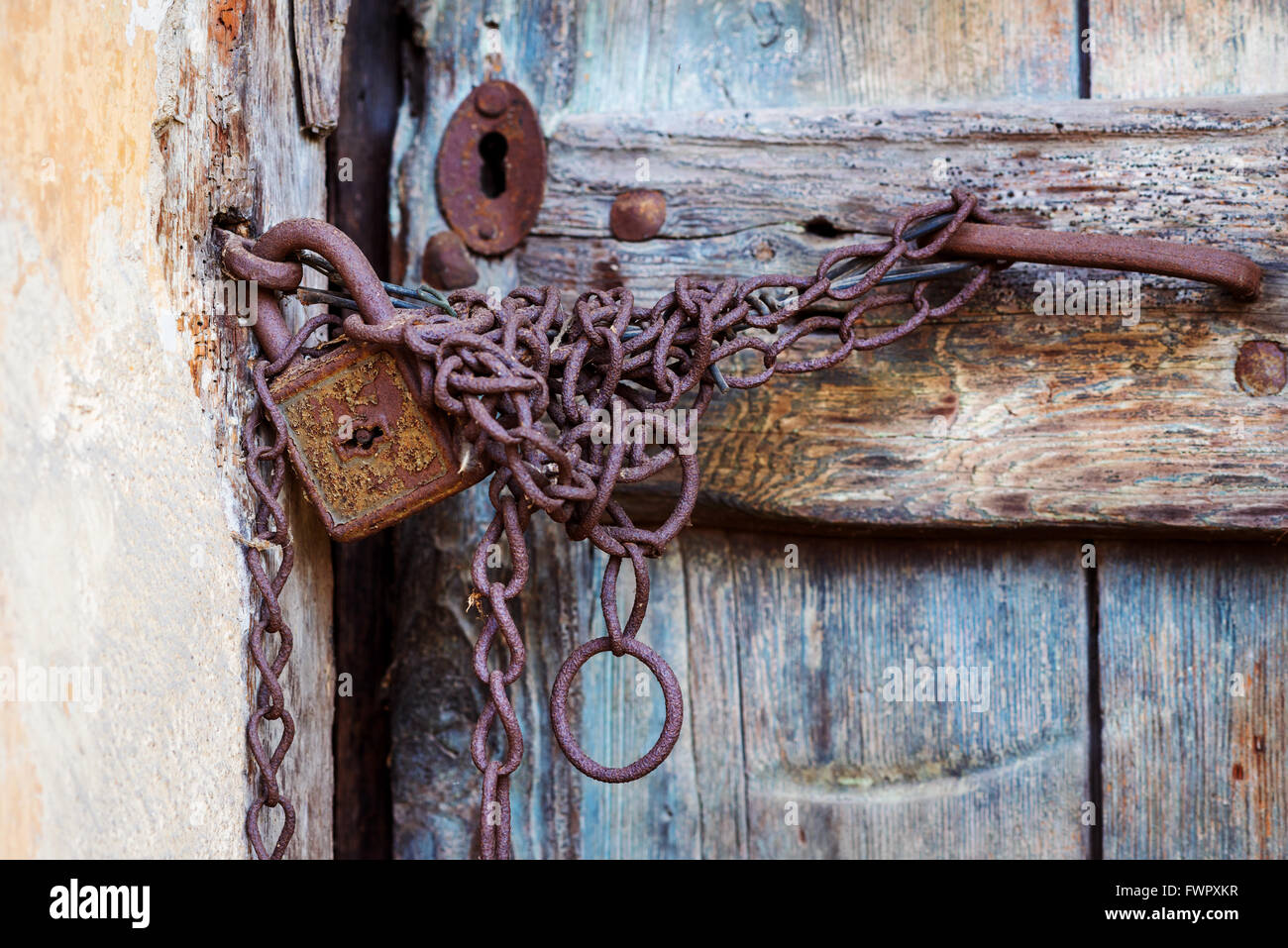 Rusty Door rusty door lock and chain on an old door stock photo, royalty free