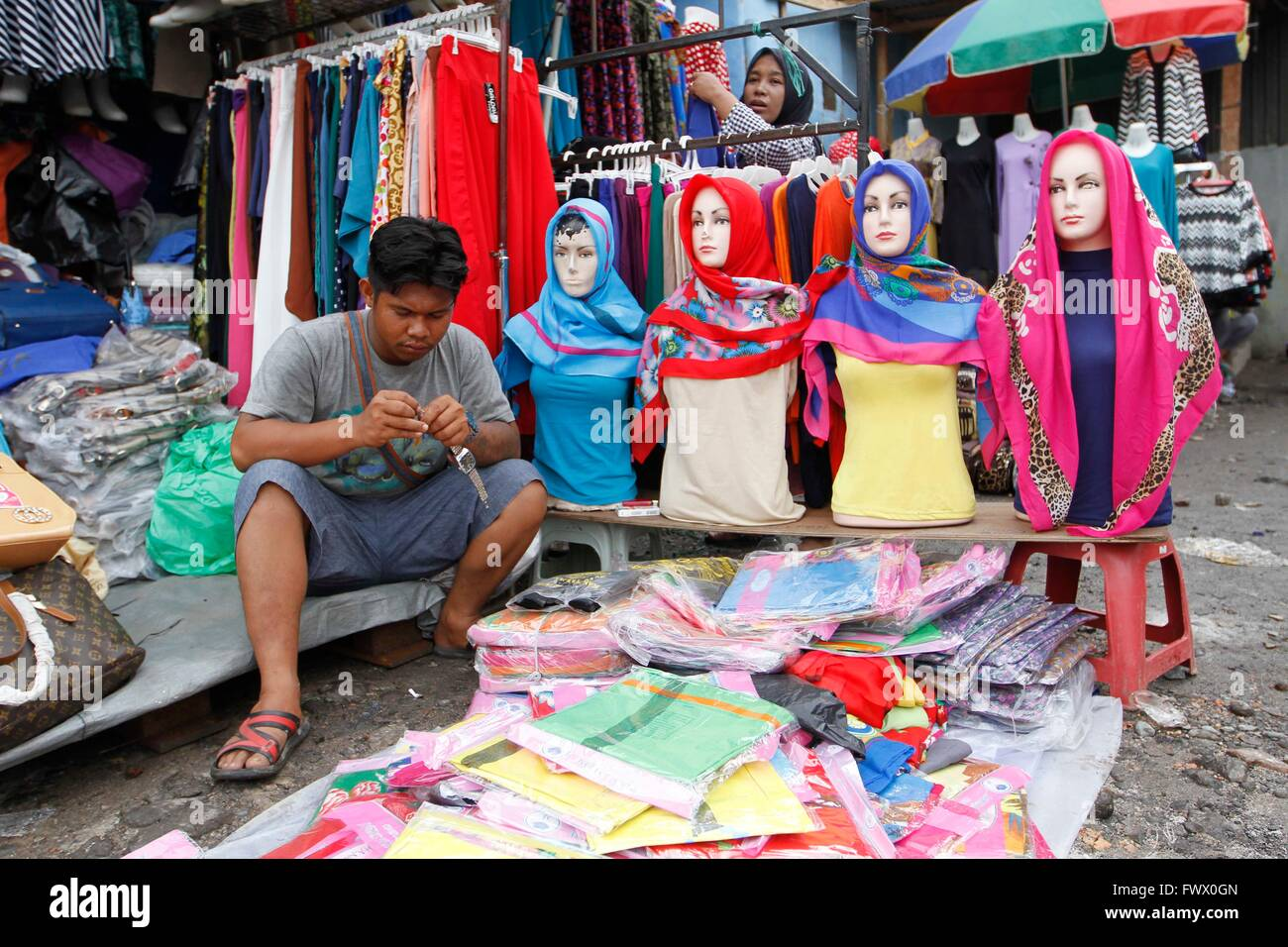 Jakarta, Indonesia. 01st Mar, 2016. A vendor waits for customers ...