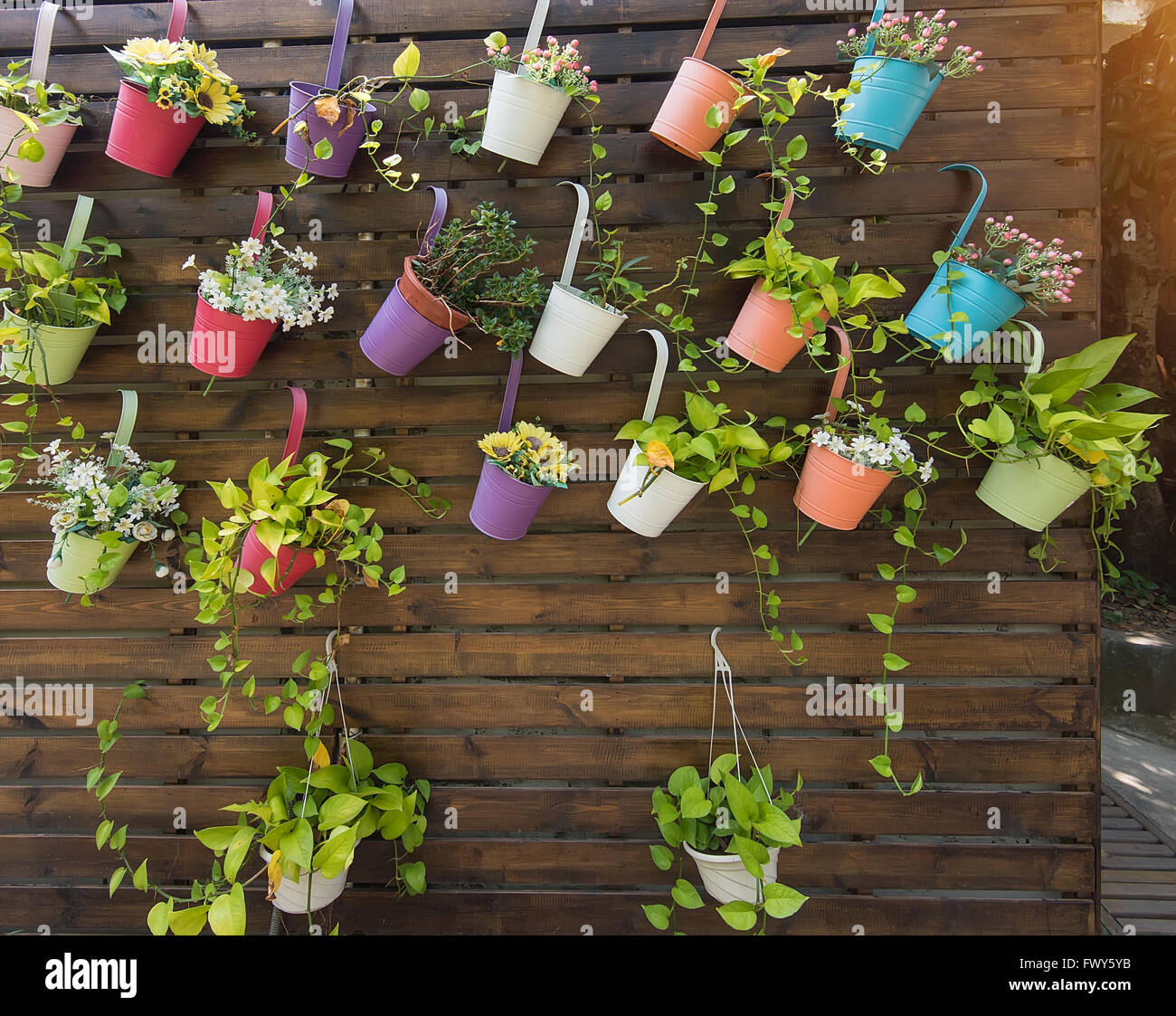 Hanging flower pots with fence stock photo royalty free for Fence hanging flower pots