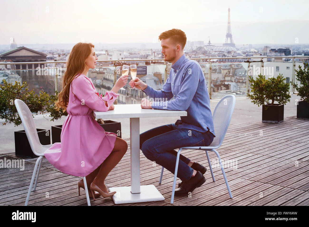 Outdoor cafe in paris with tower in background - Couple Drinking Champagne In Luxury Rooftop Restaurant In Paris With Panoramic View Of Eiffel Tower