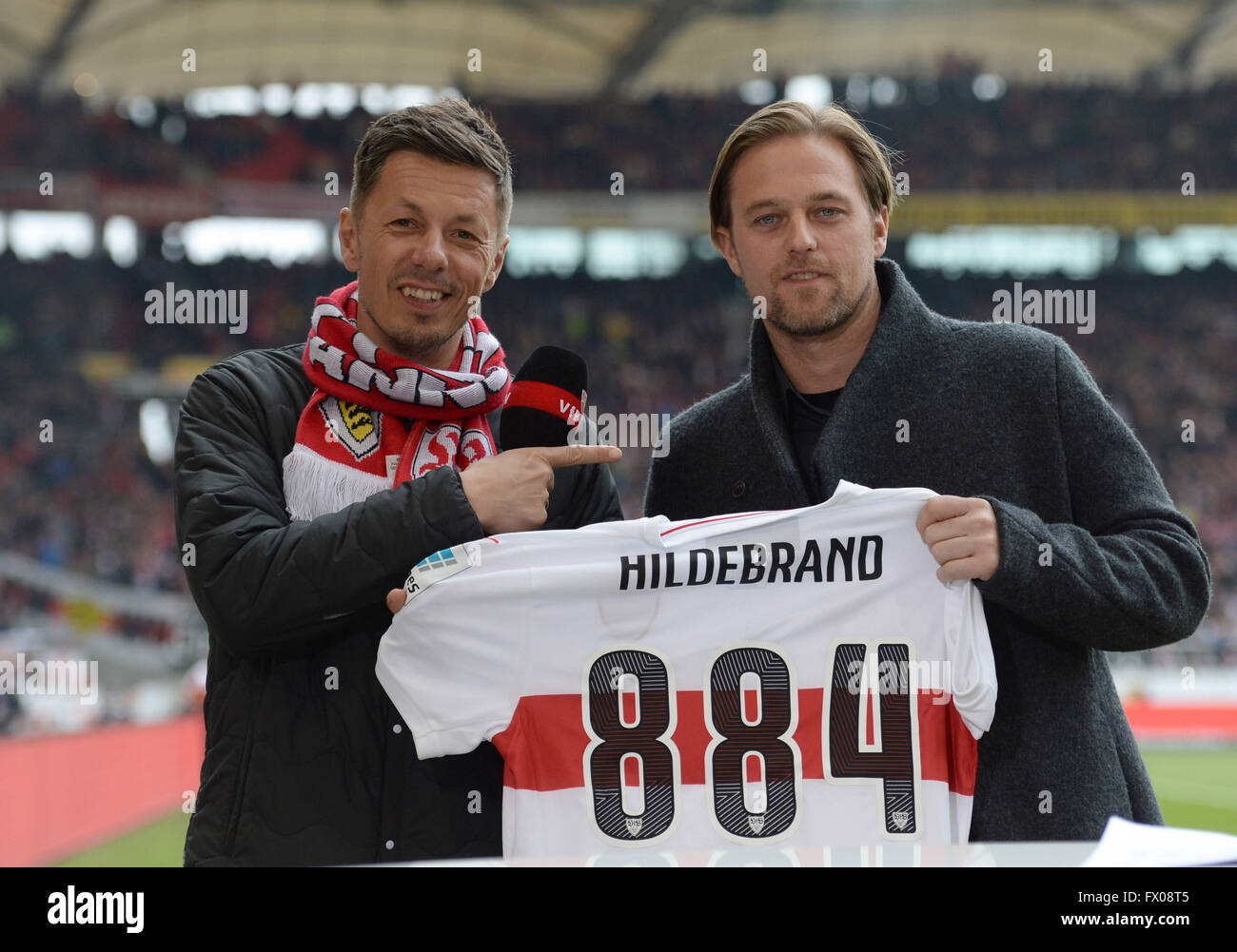 vier l and former vfb goalkeeper timo hildebrand hold up a jersey ahead of the german bundesliga soccer match between vfb stuttgart and bayern