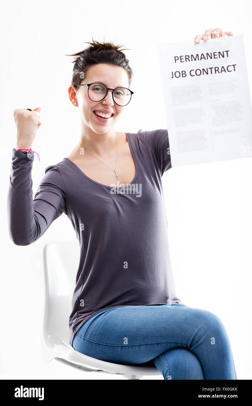 happy sitting w on glasses holding her permanent job contract stock photo happy sitting w on glasses holding her permanent job contract