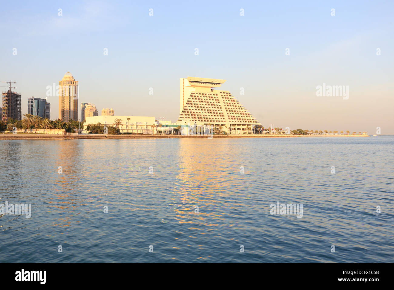 The doha sheraton right and other top class hotel buildings in doha qatar shortly before sunset january 2016