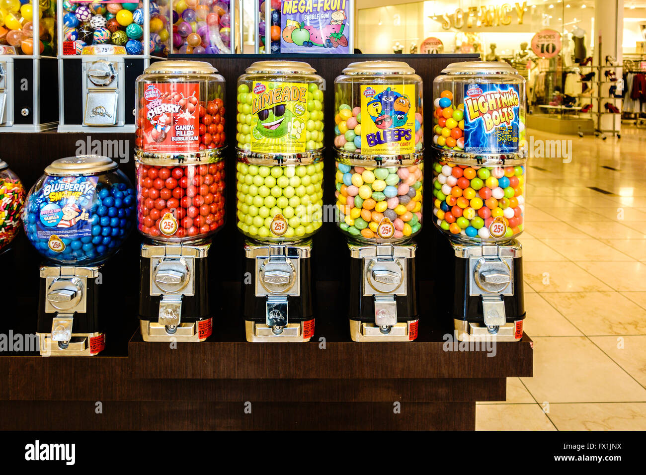 Round Candies And Bubblegum In Coin Operated Dispensers In