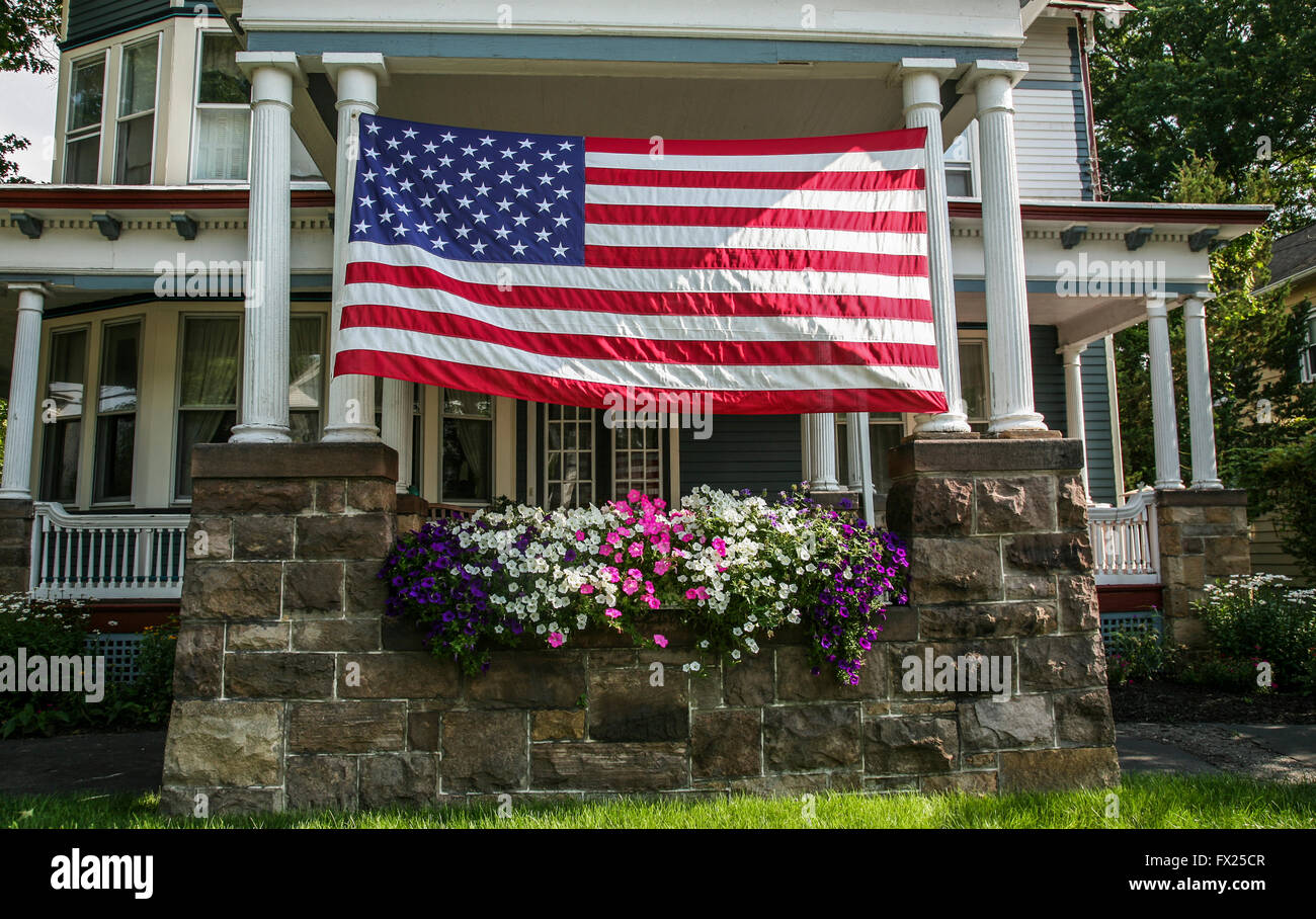 Large american flag on an old victorian house in new for Big houses in america