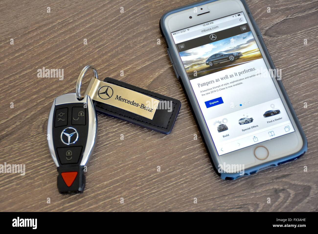 An apple iphone displaying the mercedes benz web page for Mercedes benz telephone