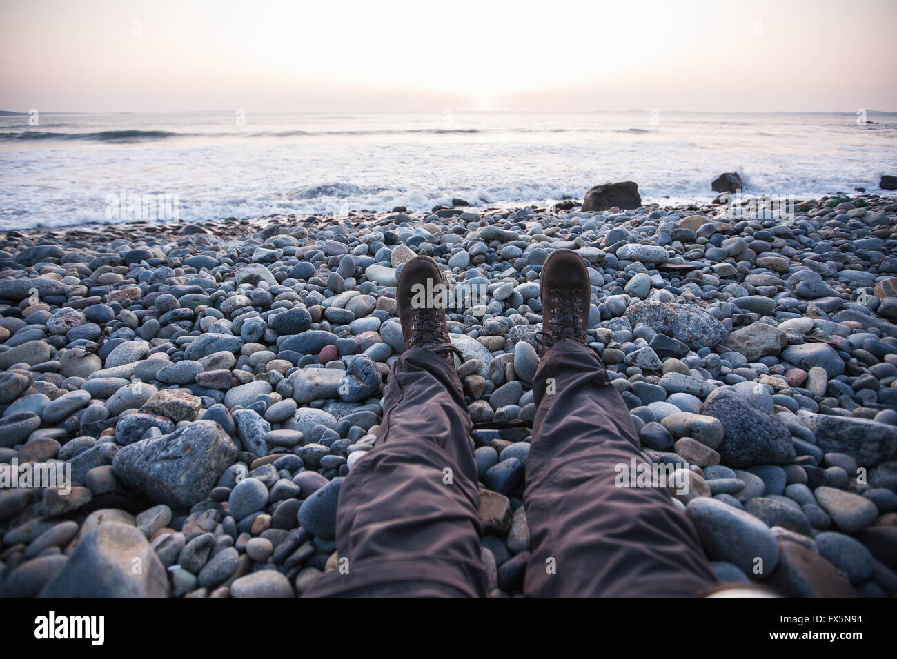 Hiker, me (model released) in hiking boots on pebble beach at ...