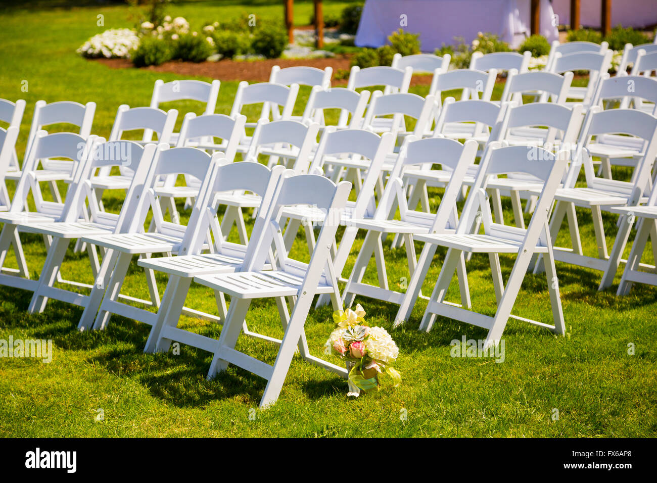 Wedding ceremony chair - Chairs In Rows For An Outdoor Wedding Ceremony On Grass In Oregon