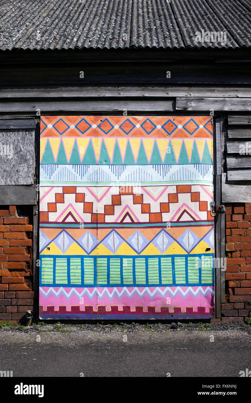Colourful Aztec Pattern Painted Garage Door. Glastonbury, Somerset, England