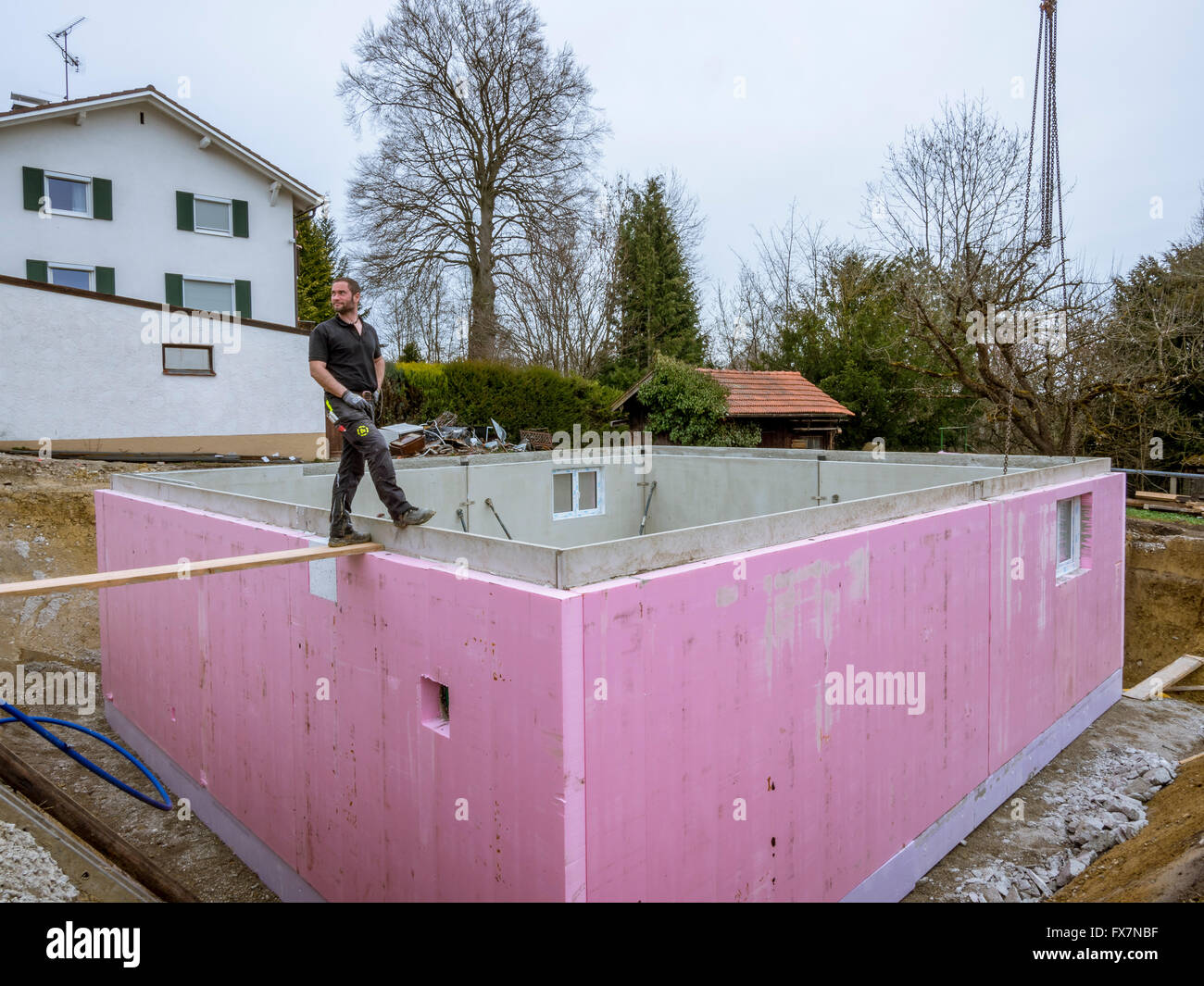 Prefabricated house workers in setting up the basement for Building a basement