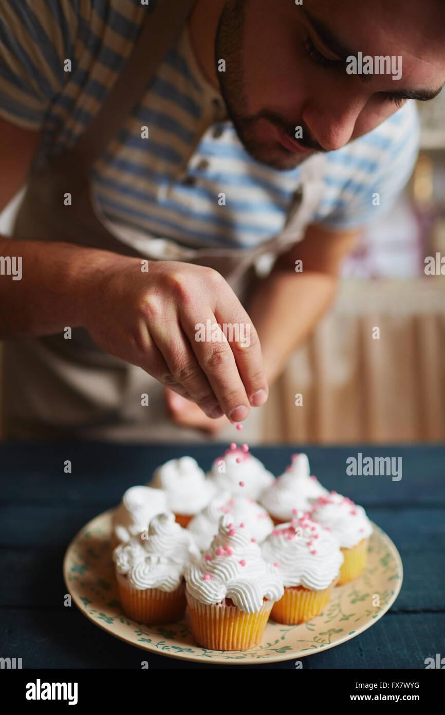 Decorating With Sprinkles Decorating With Sprinkles Stock Photo Royalty Free Image
