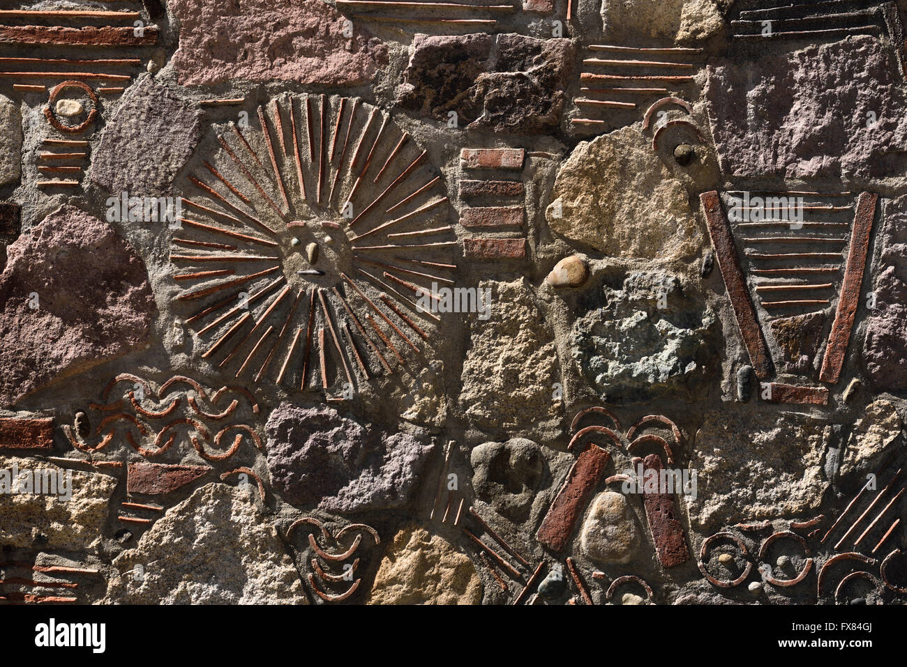 mexican sun god patterns relief in stone and tile wall. Black Bedroom Furniture Sets. Home Design Ideas