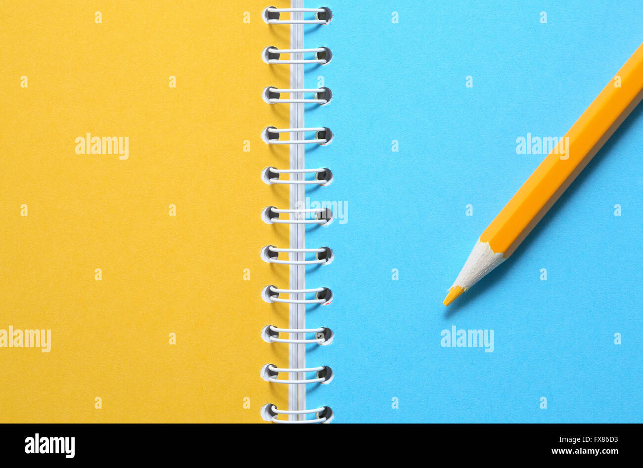 Yellow pencil on notebook with colored blank pages Stock Photo ...