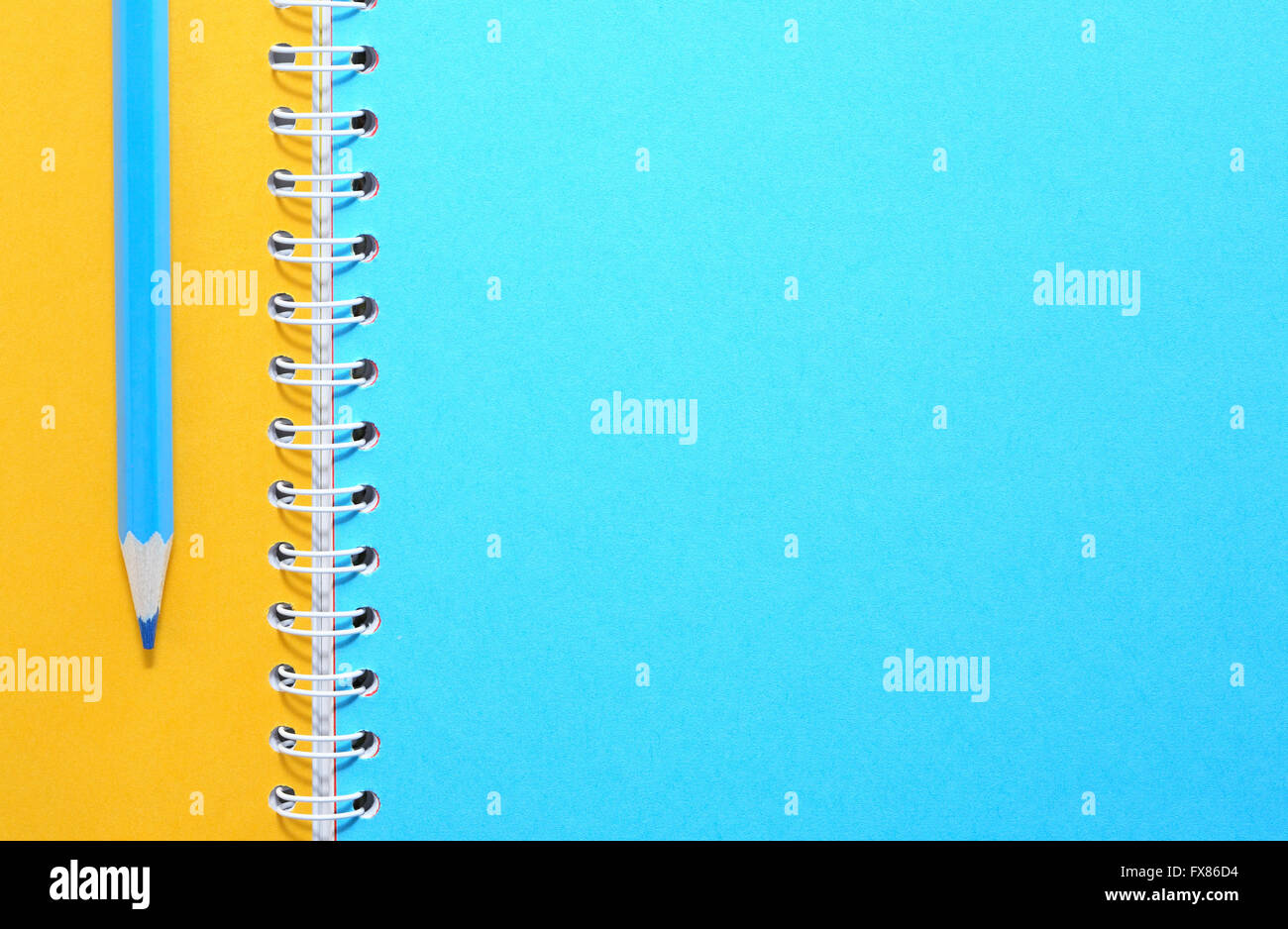 Blue pencil on notebook with colored blank pages Stock Photo ...