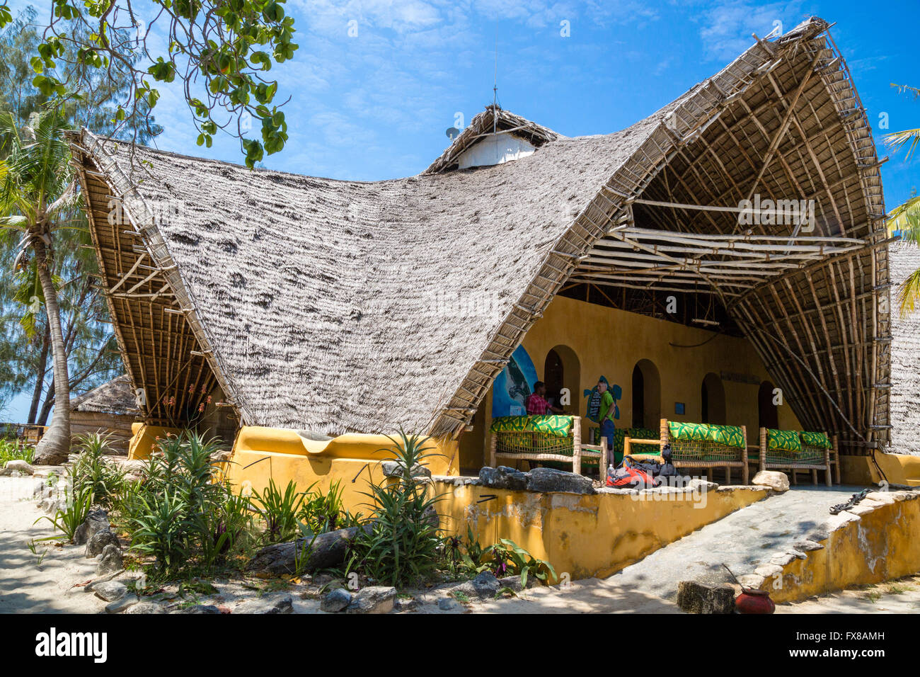 palm thatched roof of the big open visitor centre on chumbe island off the coast of - Thatched Rood