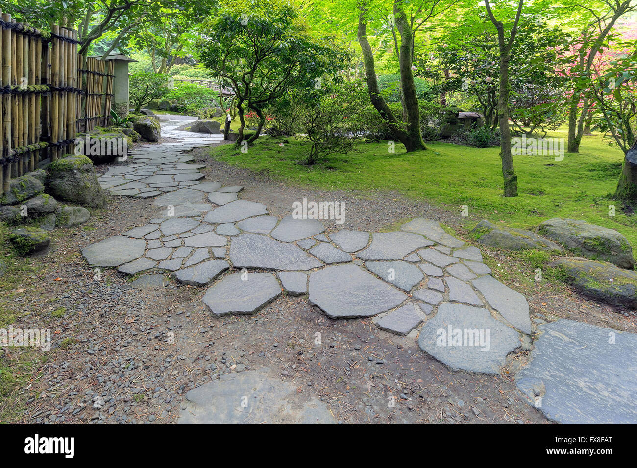 Stone Path Walkway With Bamboo Fence And Landscaping At