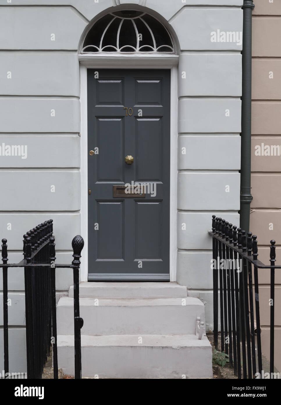 Grey six-panel Georgian style front door with fanlight in Islington ...
