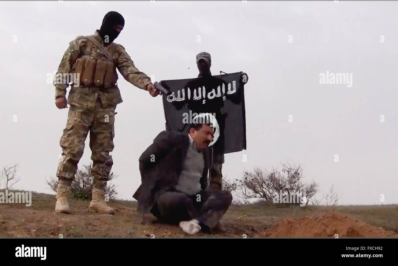 An islamic state fighter executes an iraqi government official an islamic state fighter executes an iraqi government official found during a check point along a sciox Choice Image