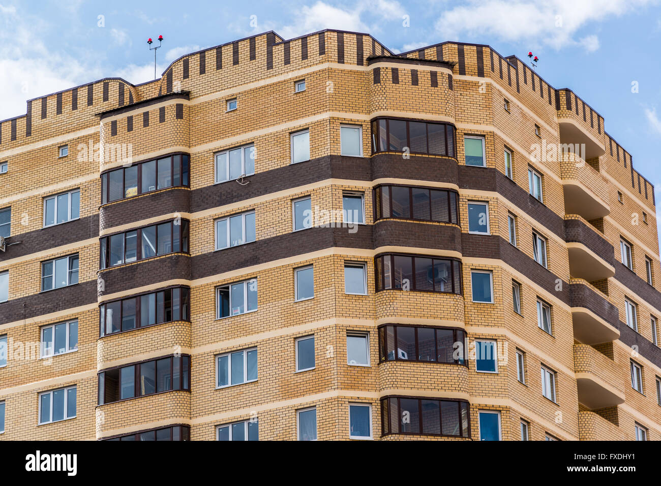 modern high rise apartment building made of brick stock photo royalty free image 102332357 alamy. Black Bedroom Furniture Sets. Home Design Ideas