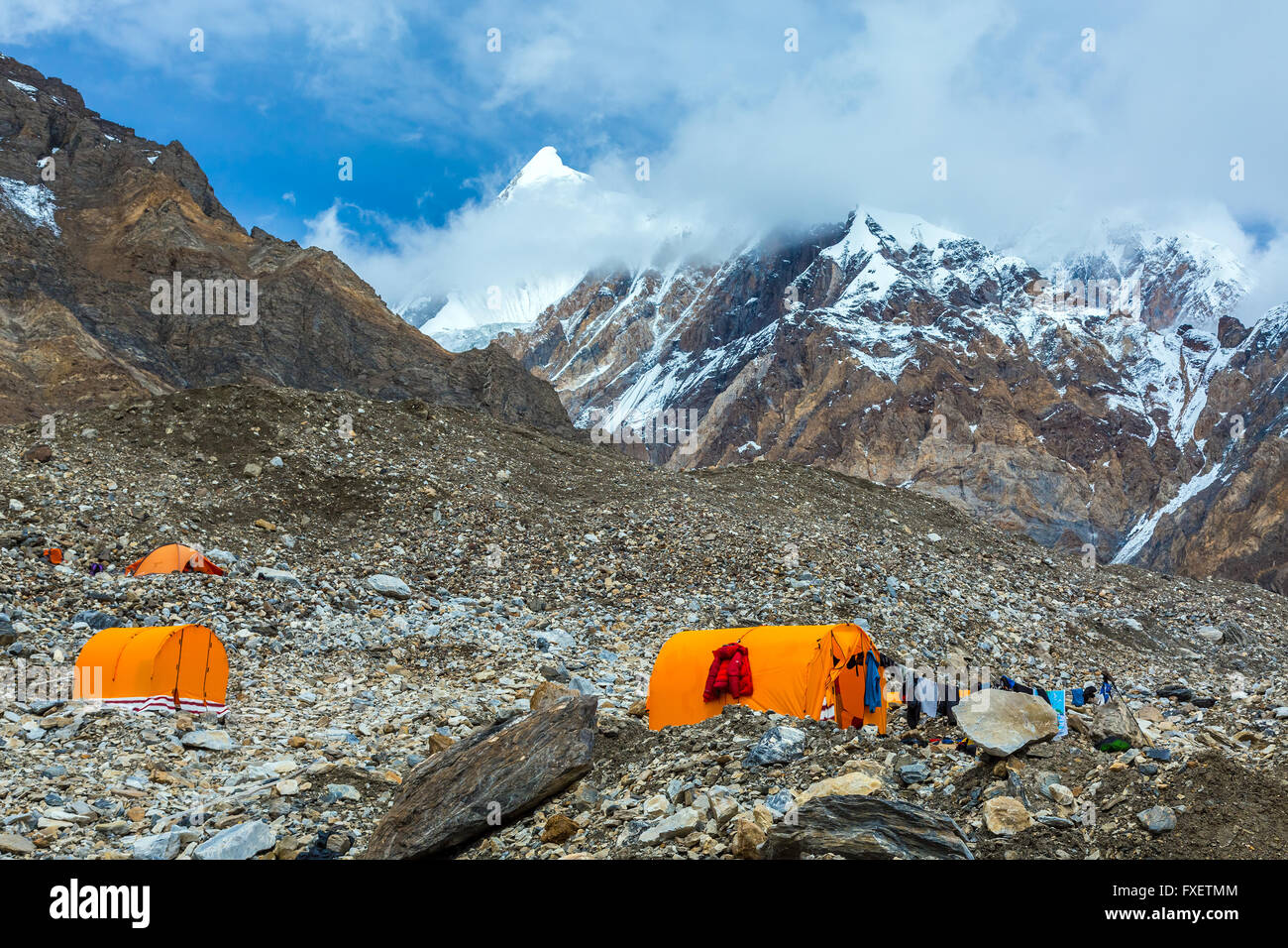 Orange Mountain Tents on Giant Glacier Moraine & Orange Mountain Tents on Giant Glacier Moraine Stock Photo ...