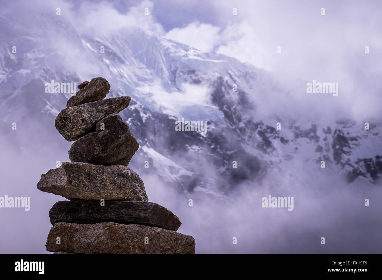 Mountain living near cusco peru royalty free stock photo - Cusco Peru In October 2015 A Stack Of Rocks In Front Of A Snow Topped Mountain Pile Of Rocks Are Often Used As Way Markers Fo
