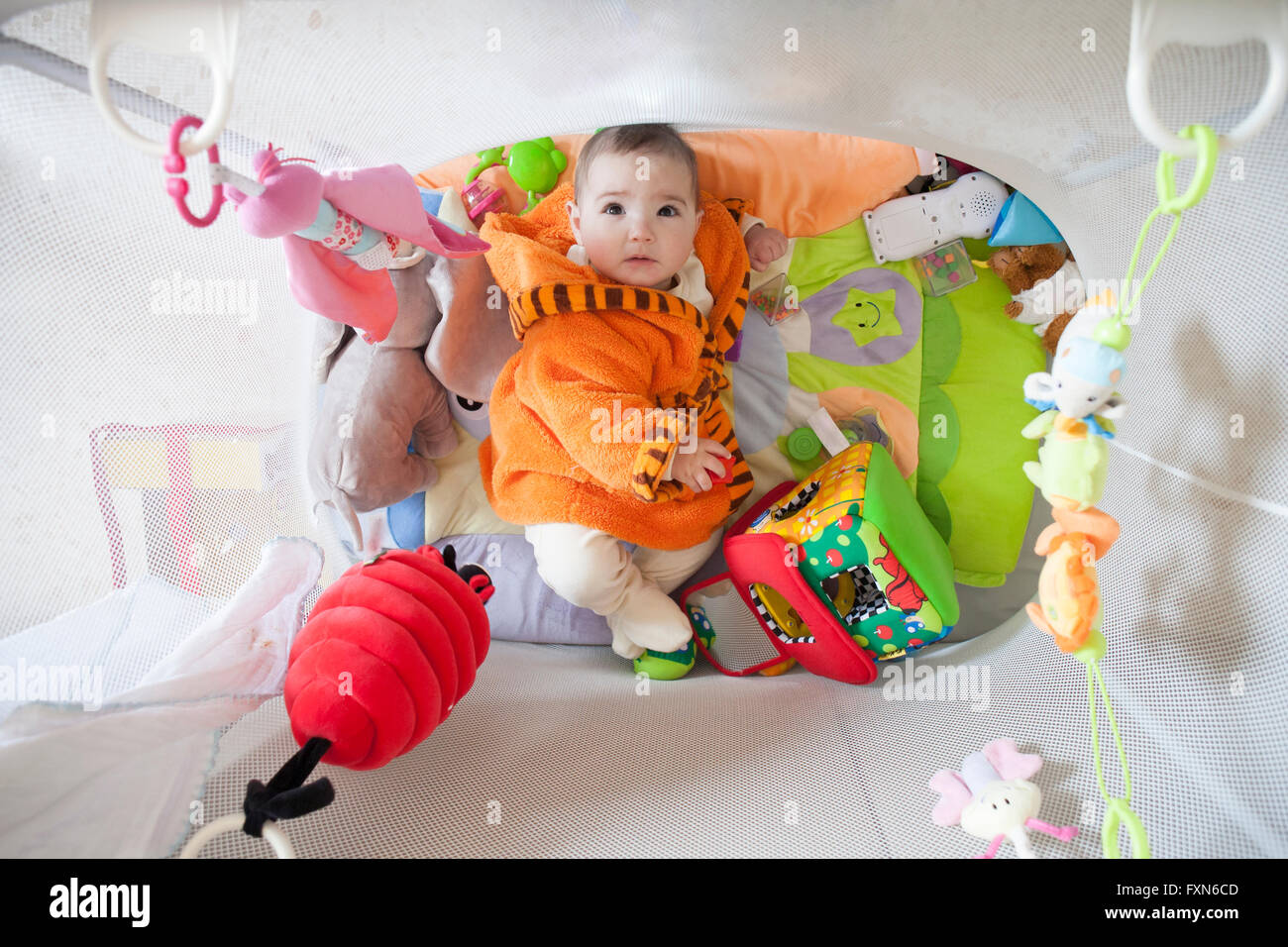 8 Month Old Toys Yarn : Cute baby girl at playpen full of soft toys months old