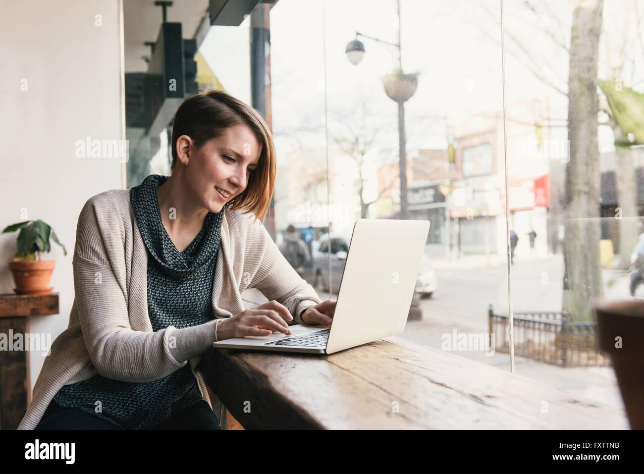 Female Customer Sitting In Coffee