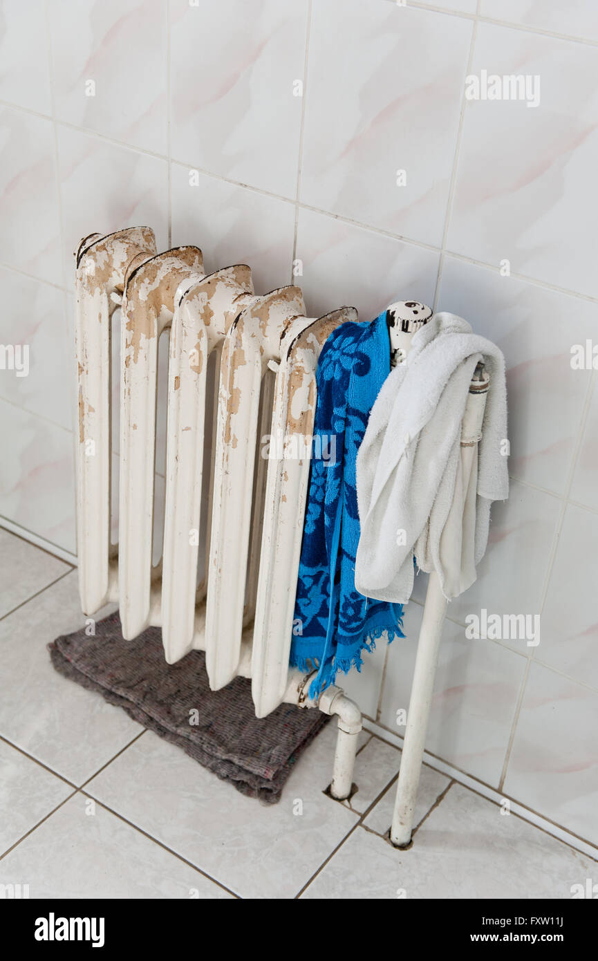 old scratched cast iron radiator white paint central heating device with hot water few