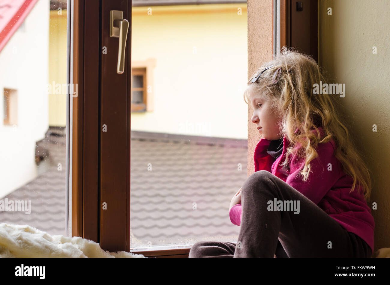 Sit In Window lonely girl sittingthe window stock photo, royalty free image