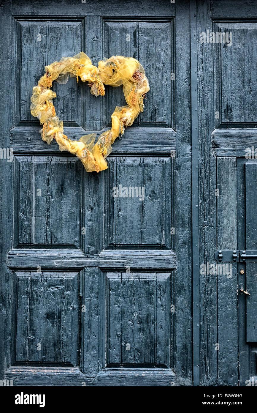 Heart shaped wreath on a wooden front door stock photo royalty heart shaped wreath on a wooden front door rubansaba
