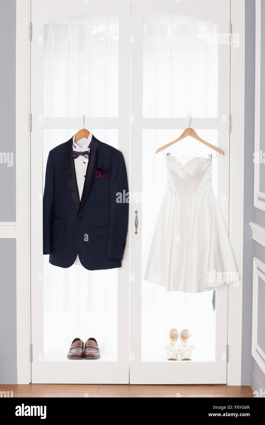 Tuxedo and wedding dress with shoes hung up on the windows Stock ...