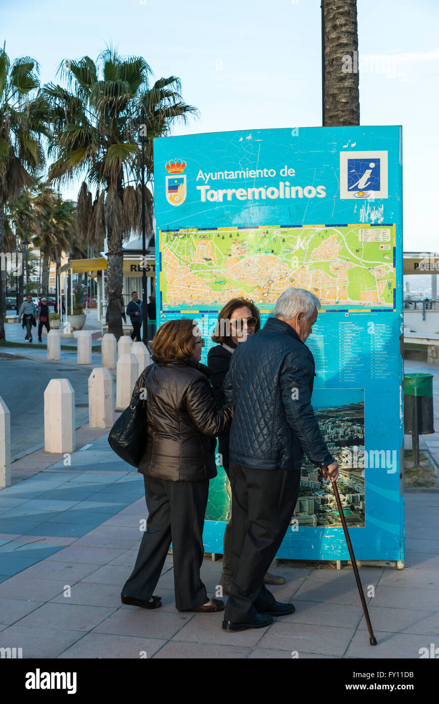 Tourists checking street map in Torremolinos Costa del Sol Stock