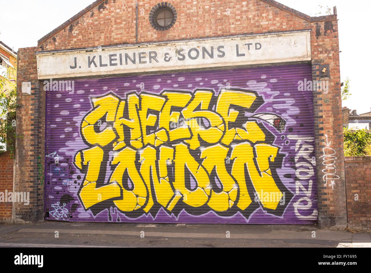 the garage doorStreet art mural on the garage door of an old brick building with