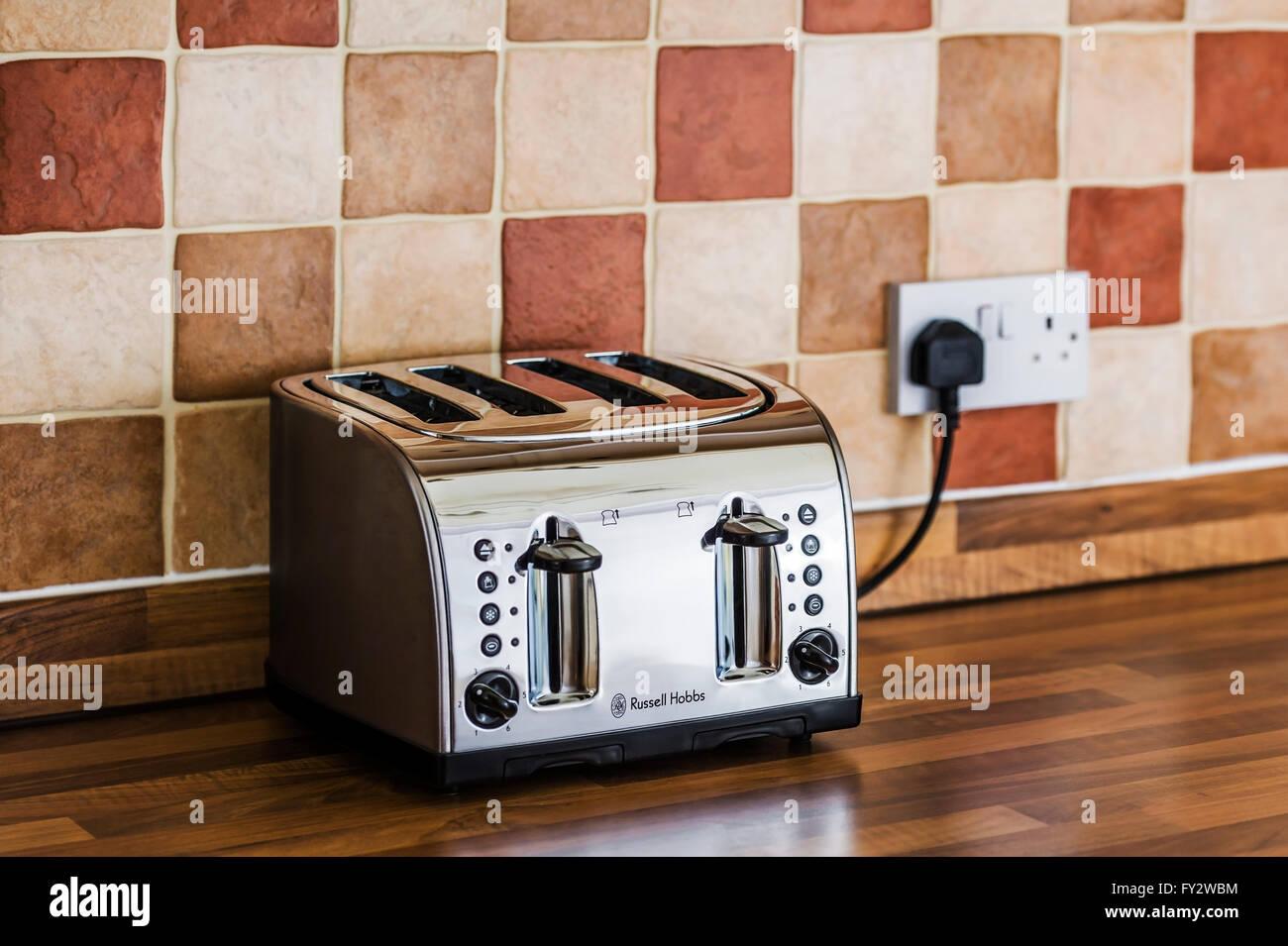 Four Slice Toaster On A Kitchen Counter Stock Photo