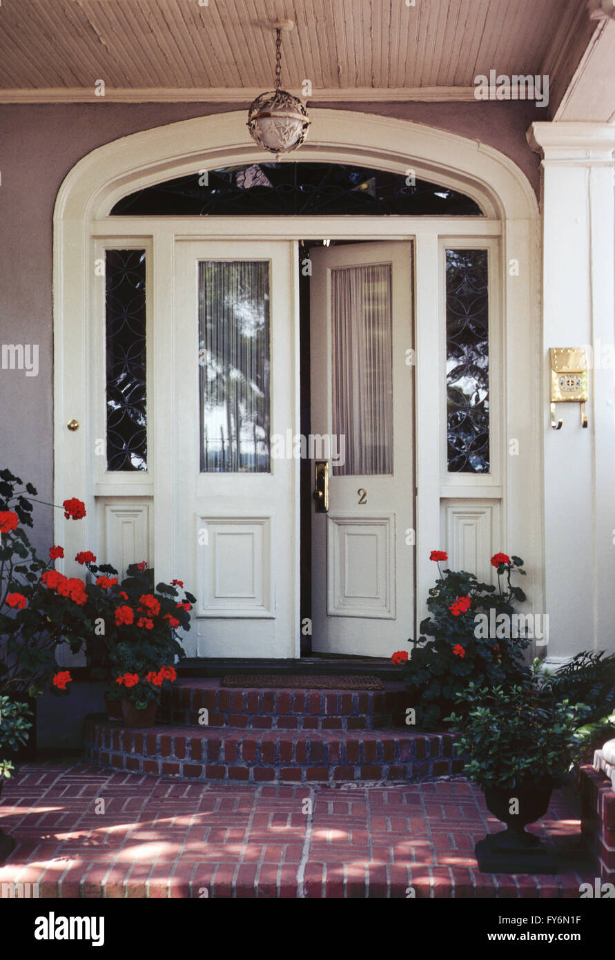 Double wooden doors with etched glass windows & brass hardware ...