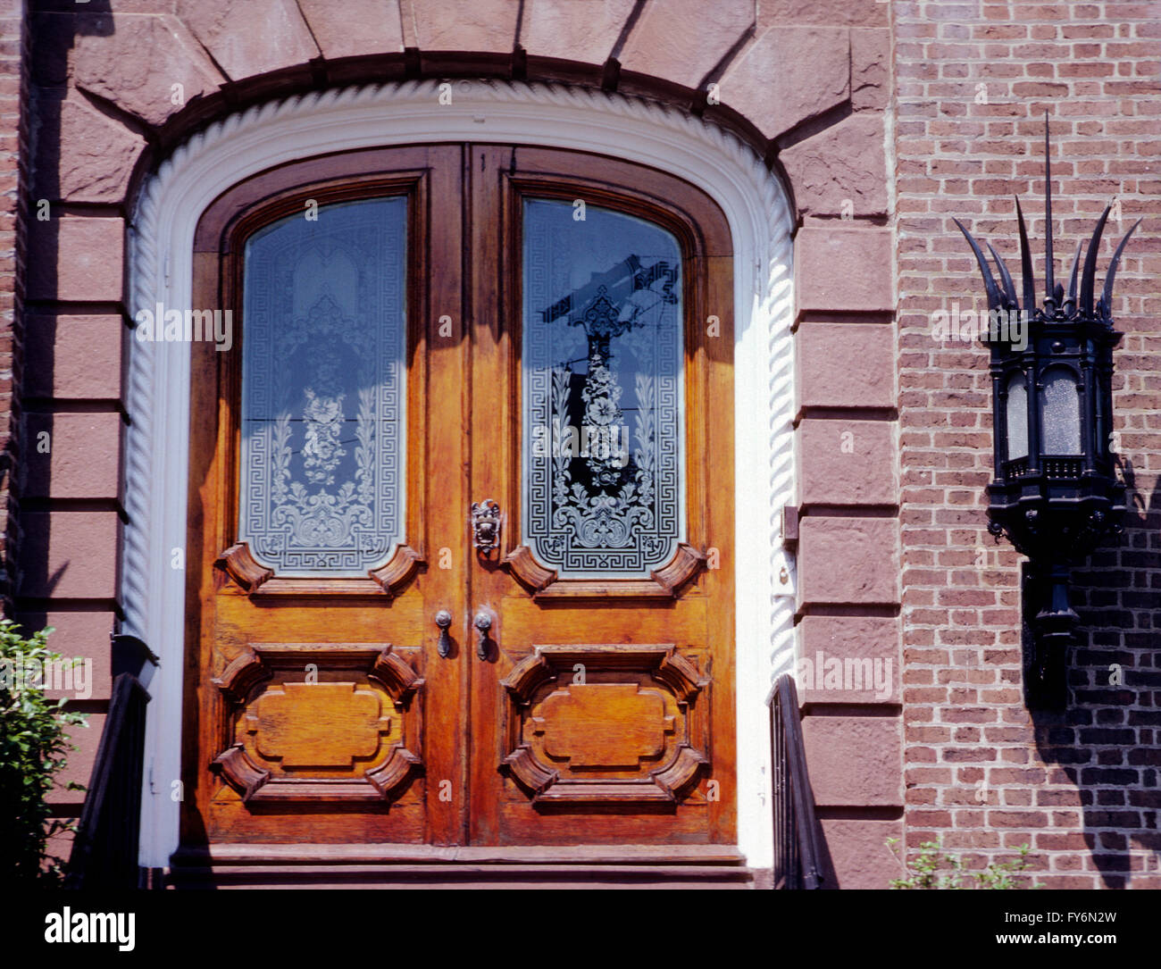Double wooden door with etched glass windows; historic old house ...