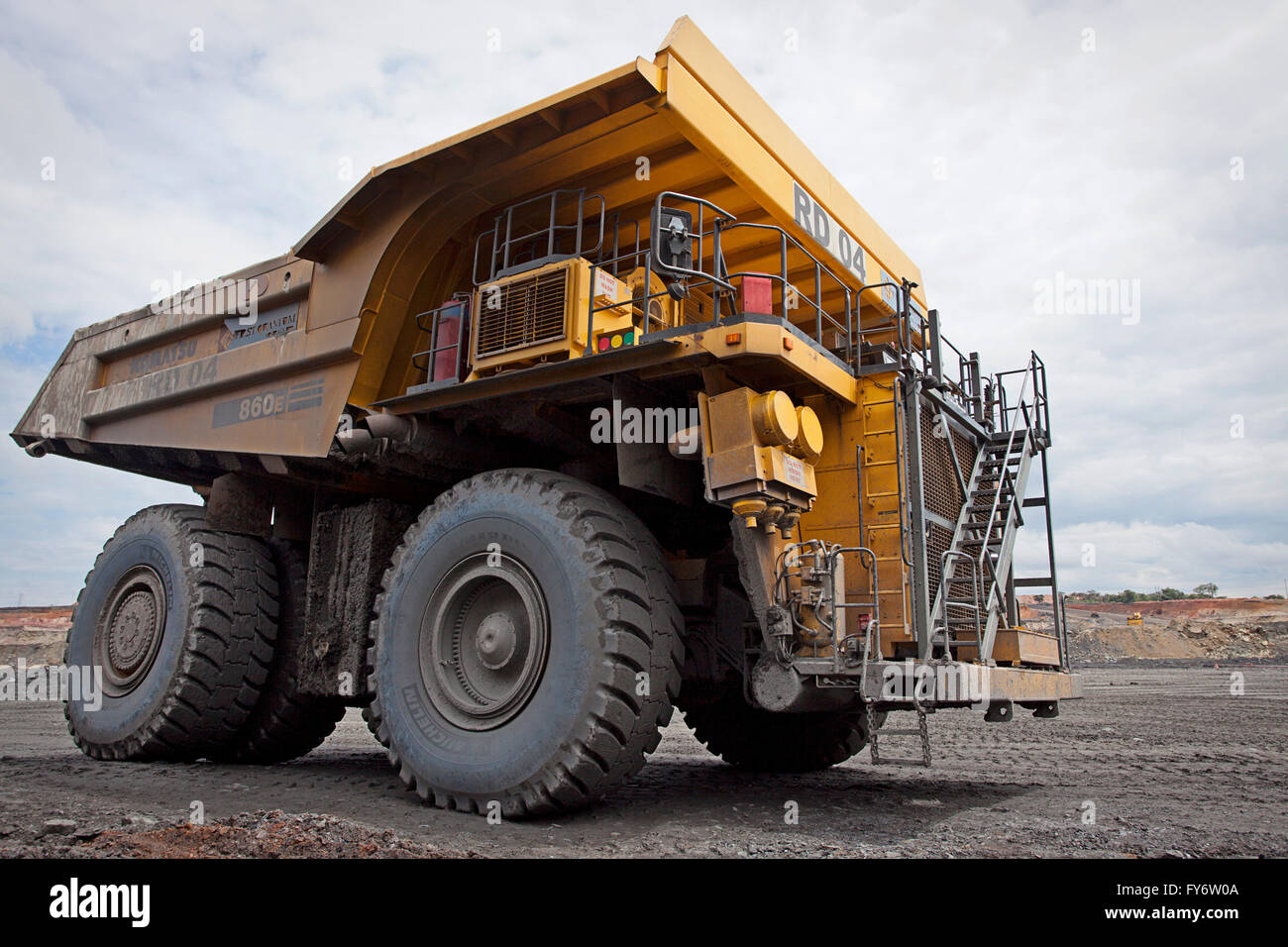 Large dump truck driving on the floor of a copper mine zambia africa