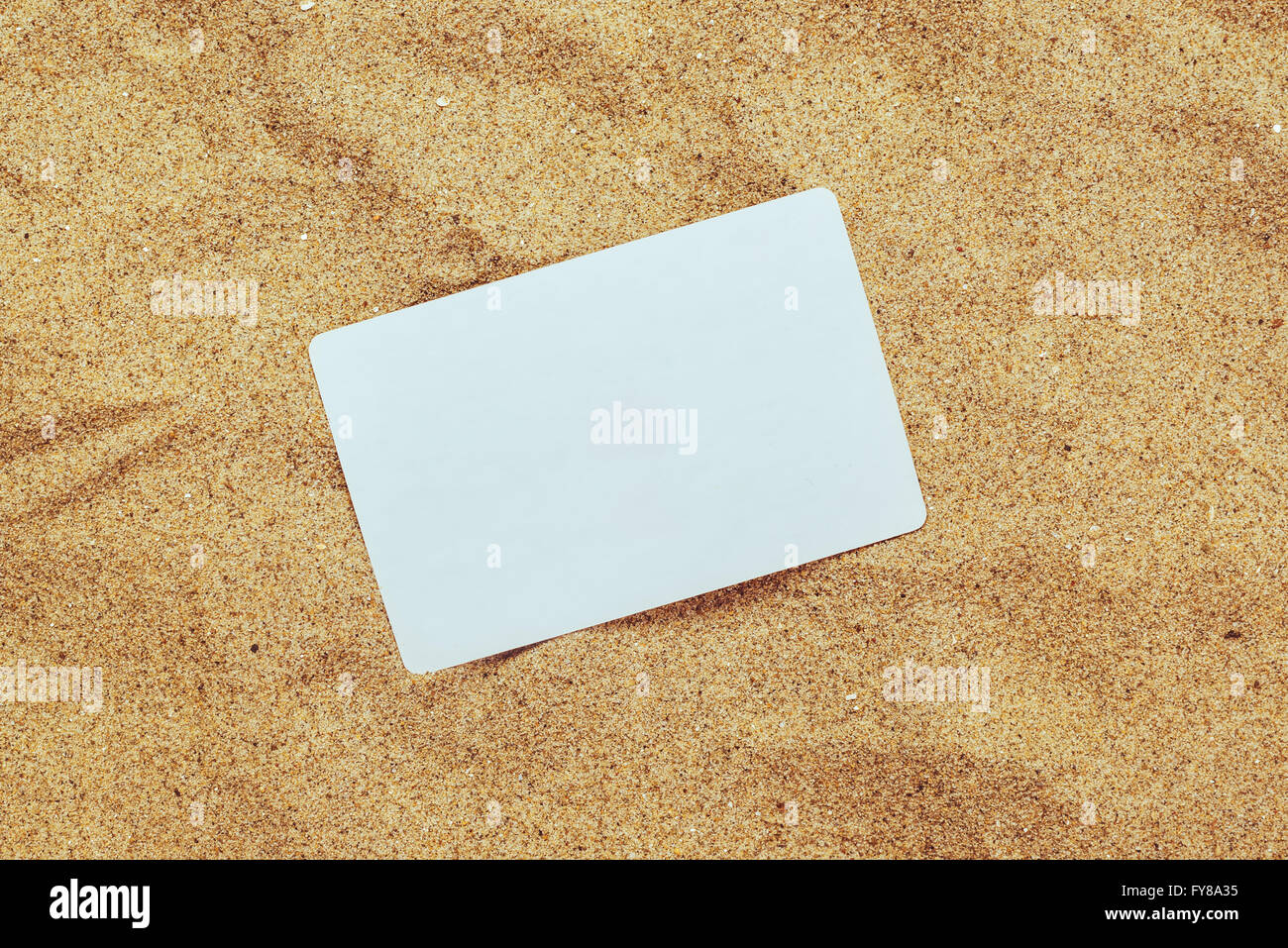 Top view of blank business card in hot beach sand, blank copy ...