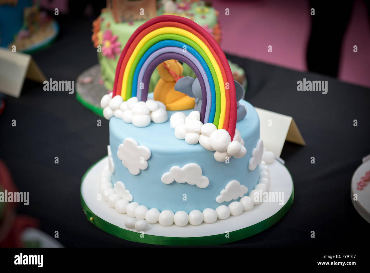 Rainbow and clouds decorative cake at Cake International ...