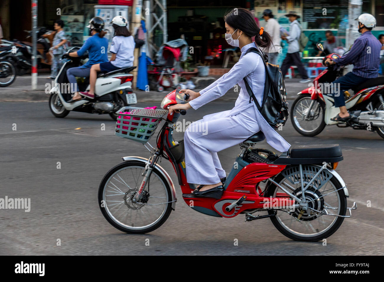 Lady In Hochi Minh City Vietnam Riding A Battery Aided